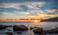 Sant Elm (Tatxon) Tags: sunset dusk puestadesol sol sun sea shore mar orilla rocas blue orange azul naranja costa coast mallorca nubes clouds sky cielo joy show beautiful