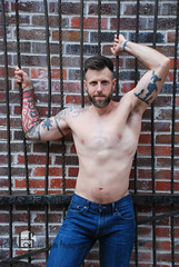 Scott (Levi Smith Photography) Tags: jeans bars man shirtless muscle cute hot tattoos abs pecs arms biceps male men mens mans fashion photography prison pose beard smirk handsome dude armpit