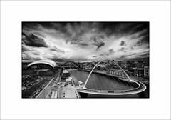 Quayside, Newcastle and Gateshead. (tkimages2011) Tags: bridge sky blackandwhite cloud monochrome river newcastle mono baltic sage tyne millenniumbridge quay gateshead he tyneside quayside blinkingbridge
