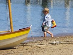 by the shore - explored 7/03/15 (saudades1000) Tags: boy summer water childhood child play boots shore verano innocence seashore menino verao candidphoto beachtime summerscene summerplay