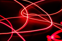 Abstract Christmas Lights (mraarondouglas) Tags: christmas lights light abstract blur rays lines swirls swirl circle curves curvy straight zoom movenment zooming long exposure exposures red magenta