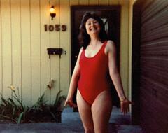 Lady In Red (~ Lone Wadi ~) Tags: swimsuit swimwear bathingsuit outdoors house residence brunette lostphoto unknown retro 1980s