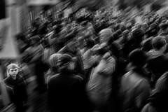 Alone Amongst Many (Isaac Hilman (@lightofisaac)) Tags: alone child kid staring looking chaotic crowds monochrome shifting motion blur people street photography fuji fujifilm xt1 victoria bc canada isaachilman