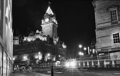 urban ghosts on the prowl, can you spot them (lunaryuna) Tags: scotland capital edinburgh architecture balmoral hotel street buildings urbanconstructs night nightlights citylights nocturnalphotography nightphotography le longexposure cityghosts streetlights beauty winter season seasonalbeauty christmasdecoration blackwhite bw monochrome lunaryuna