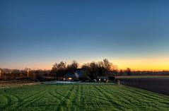 A Dutch farm watching the sunset. (Alex-de-Haas) Tags: 1635mm d750 dutch grebpolder hdr holland hollandseluchten nederland nederlands netherlands nikkor nikkor1635mm nikon nikond750 noordholland warmenhuizen akker akkers avond beautiful boerenland calmweather clearsky daglicht daylight dusk evening farmland flat hemel highdynamicrange house huis landscape landschap licht light longexposure lowlight lowlightconditions lucht mooi onbewolkt polder schemer schemering skies sky sunset vlak weather weer winter winteravond woning zonsondergang