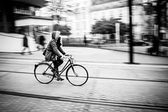 Balade nantaise à vélo (dono heneman) Tags: balade promenade ride nantaise vélo bike bicycle noiretblanc nb blackwhite filé urbain urban urbaine ville city gens people human humain femme woman rue street rail track immeuble building batiment nantes loireatlantique paysdelaloire france pentax pentaxart pentaxk3