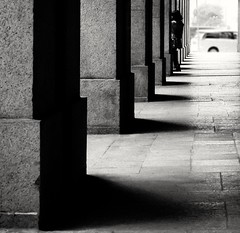 Black & White (❀Janey Song) Tags: hongkong blackwhite black white bw street shadow column building light hallway people