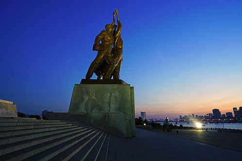 Worker, intellectual & peasant sculpture at sunset, Pyongyang Juche Monument