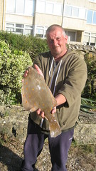 "Gary Wylde with a lovely Plaice caught in the Jurassic Open - 2015 • <a style=""font-size:0.8em;"" href=""http://www.flickr.com/photos/113772263@N05/19234705863/"" target=""_blank"">View on Flickr</a>"