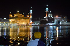 A devotee praying by the holy sarovar. (Pharheen) Tags: street travel portrait people india architecture night alone religion culture solo punjab amritsar sikhism goldentemple