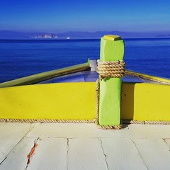 Salt of the Sea (N.K Photography) Tags: sea water blue yellow green greece agistri ocean winter wood rust weather