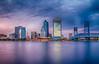 Jacksonville Skyline (Photos By RM) Tags: longexposure sunset jacksonville florida usa bluehour bridge water sky clouds canon canon7d slowshutterspeed wellsfargo skyline