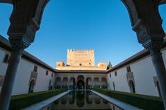Al-Andalus (Oliver J Davis Photography (ollygringo)) Tags: alandalus andalus andalusia andalucia granada spain europe travel moorish history heritage world site unesco construction muslim islam islamic arabic architecture arch walls patio pond water reflection reflections tourism tourists people palace fort fortress fortification tower blue sky warm sunny winter nikon d90 courtofthemyrtles towerofcomares court myrtles comares alhambra royal arrayanes patiodelosarrayanes patiodelaalberca pool torredecomares torre iberia style culture medieval
