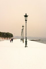 Snow Promenade (Blues Views) Tags: thessalonikigreece thessaloniki greece neaparaliathessaloniki neaparalia nature water walking walkers sea snowinthessaloniki snow sky pink white cold lampost lamps weather sigma sigmalens sigma1770mmf2845dcmacrolens canon600d canon earlymorning exercise ocean promenade salonika outdoors outside trees urbantrees urbannature redscarf macedoniagreece makedonia timeless macedonian μακεδονια