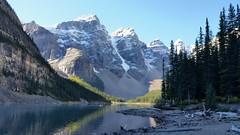 Beautiful view of Moraine Lake, Alberta, Canada. (jess_k_kent1) Tags: moraine lake rocky mountains snow capped alberta canada valleyofthetenpeaks peaks water reflection shore