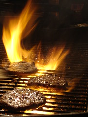 sizzling patties on a grill