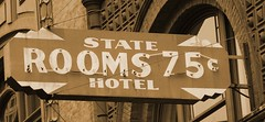 Hotel Deals in Seattle (Audentes) Tags: seattle signs building 20d monochrome sepia architecture canon eos hotel antique deal cheap pioneersquare inexpensive