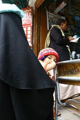Child behind his mother looking at camera - Yemen (Eric Lafforgue) Tags: voyage travel republic middleeast arabic arab arabia yemen arabian sanaa ramadan yemeni yaman middleast arabie moyenorient jemen lafforgue arabiafelix  arabieheureuse  arabianpeninsula    ericlafforgue iemen lafforguemaccom mytripsmypics imen imen yemni    jemenas    wwwericlafforguecom  alyaman ericlafforguecomericlafforgue contactlafforguemaccom yemenpicture yemenpictures