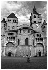 cathedral with lone cyclist (lysander07) Tags: bw analog germany europe quiet noiretblanc dom empty gothic tlpoedeleted myworld lonely trier endofsummer lysander07 strangeplaces 555v5f noireblanc
