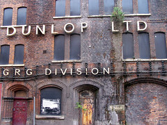 DUNLOP LTD (Neil101) Tags: door old uk england urban building brick history mill abandoned sign architecture macintosh manchester interesting factory kodak decay empty bricks entrance neil warehouse doorway most mills derelict oldbuilding redbrick regeneration wilkinson z740 warehose neilwilkinson neil101 bbcmanchesterblog