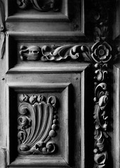 Door Engraving (Andrew Hefter) Tags: door blackandwhite bw texture film church sanantonio 35mm pentax kodak concepcion engraving mission bw400cn