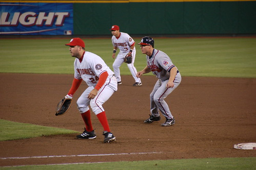 Washington Nationals Nick Johnson holds Atlanta Braves Pete Orr at first base