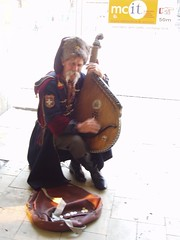 Guy dressed in Military outfit playing instrument (tbertor1) Tags: poland krakow polish tulio bertorini tuliobertorini