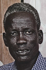Man with decorative scarifications on the face in Port Sudan (Eric Lafforgue) Tags: africa black soedan sudan tribe scars soudan theface eastafrica sudanese denka shluh lafforgue  sudn ericlafforgue lafforguemaccom szudn  mytripsmypics sudo     republicofsudan    xuan