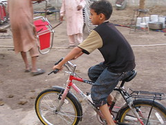 Joys of new Bike (*Muhammad*) Tags: pakistan bike child joy punjab a75 thrill walima khanewal