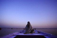 Varanasi (dwrawlinson) Tags: blue woman india sunrise river boat solitude religon varanasi spiritual hindu ganges top20india ak10