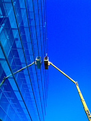 Crane (Sami__) Tags: cameraphone blue windows sky abstract finland nokia helsinki phone crane cell symmetry minimalism sanomatalo 6270 abstractbyinvitationonly