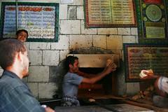 Baker taking bread out of the oven - Yemen (Eric Lafforgue) Tags: republic arabic arabia yemen arabian ramadan yemeni yaman arabie yemenia jemen lafforgue arabiafelix  arabieheureuse  arabianpeninsula ericlafforgue iemen lafforguemaccom mytripsmypics imen imen yemni    jemenas    wwwericlafforguecom  alyaman ericlafforguecomericlafforgue contactlafforguemaccom yemenpicture yemenpictures