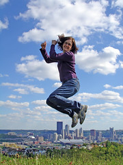 Jul Jumps Pittsburgh (elston) Tags: city skyline clouds jump jumping pittsburgh julie sweetfreak pittsburgh052006 flickr:userid=30575157n00
