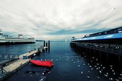 stormy sunday at the waterfront (poopoorama) Tags: seattle blue red sky seagulls water birds tag3 taggedout ferry clouds digital boat washington dock nikon tag2 tag1 waterfront d70 sigma ivars canopy 1020mm letsplaytag tarp sigma1020mm