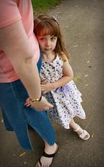 Shy (Glenn Loos-Austin) Tags: girl bikepath kid eyes pretty child sweet candid gorgeous bodylanguage shy potd hiding client 1022mm photooftheday canon1022mm 22mm psportrait portraitshoot