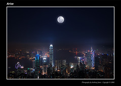 Arise (VJ Spectra) Tags: china city moon colors skyscraper buildings d50 hongkong lights nikon exposure cityscape timeexposure moonrise nikkor kowloon ifc bankofchinatower hongkongisland victoriapeak overthemoon firsttheearth diamondclassphotographer flickrdiamond v1224f28my1407 fteoverthemoon