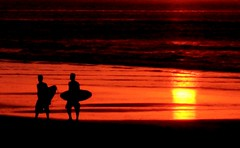 pulang (Farl) Tags: travel sunset red sea bali orange sun reflection colors indonesia gold coast surf waves waters surfers surfboards tradition kuta
