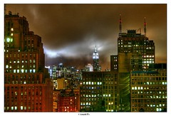By a Cloudy Night - HDR (Arnold Pouteau's) Tags: from nyc newyorkcity longexposure newyork night clouds downtown manhattan midtown esb outsidethewindow hdr nyc10 50ms