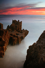 Red rock, red sky (sengsta) Tags: ocean longexposure sunset beach landscape rocks surf perth northbeach westernaustralia mettamspool hammersleypool
