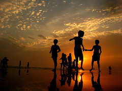 Play II (ali khurshid) Tags: pakistan sunset sea reflection beach childhood silhouette youth clouds children fun jump play time personalfav karachi alikhurshid clifton cotc creamofthecrop seaview lowangle mostfaved boysandgirls changinglight 100favs 26062006 26thjune2006 areallybeautifulday exhibition14august 350views63favs 506views74favs 556views82favs cotcmostfavorites 707views98favs 100favs14days722views 45comments 780views107favs alikhurshidsummerphotography 800views112favs world100f