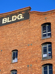 Building (Jennifer Hattam) Tags: sf sanfrancisco blue windows red building brick sign digital guesswheresf foundinsf sfchronicle96hours sfchronicle96hrs mission75 gwsf5party gwsflexicon
