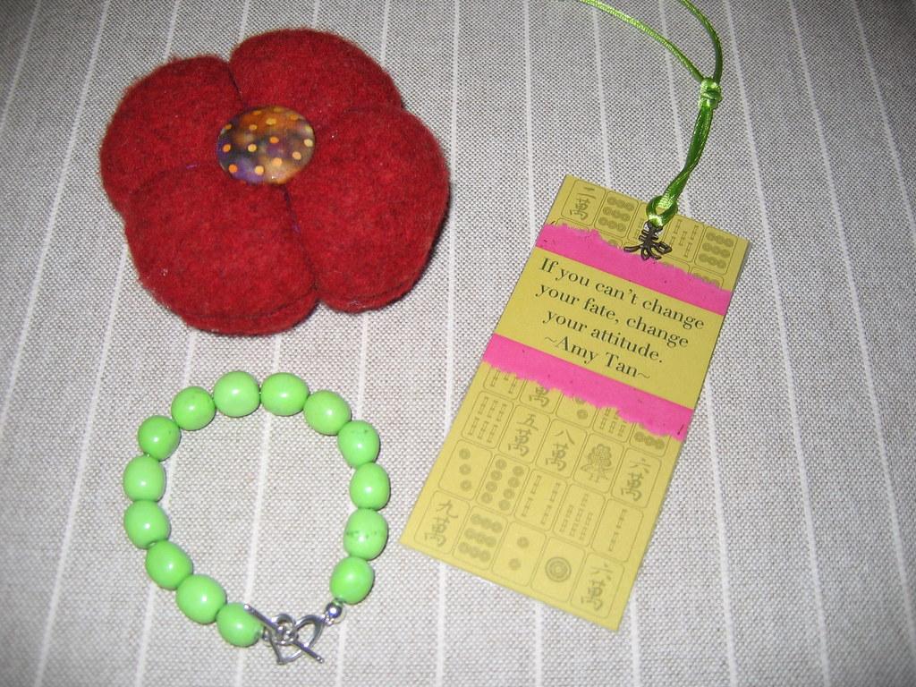 Pincushion, bracelet, bookmark