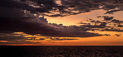 A Beautiful Sky (--Welby--) Tags: fuji xt10 hexanon ar 40mm f18 sunset beautiful sky skies clouds orange purple sea coast brilliant ocean