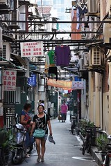 Narrow streets of downtown (Thorsten Reiprich) Tags: china road city summer urban woman travelling walking asia day heat prc