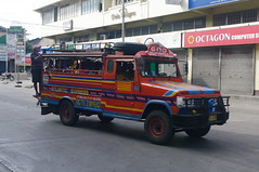 Jeepney, Dumaguete, Negros Oriental, Philippines (ARNAUD_Z_VOYAGE) Tags: islands island philippines landscape boat sea southeast asia city people volcano amazing asian moutains sunset street action cars jeepney tricycle architecture river tourist capital town municipality filipino filipina colors building house provincial province village altitude mountain mountains dumaguete negros oriental philippine