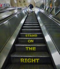 We Drive On The Left (Douguerreotype) Tags: london england people tunnel uk underground urban british stairs city escalator britain subway gb metro tube steps