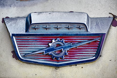 Shield of patina -[ HSS ]- (Carbon Arc) Tags: sliderssunday hood ornament ford f100 fseries truck pickup patina shield badge gear lightning bolt 1964 64 1961 1962 1963 1965 1966 61 62 63 65 66 vintage classic