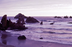 Heavenly Shades of Night are Falling, Bandon, OR 1976 (inkknife_2000 (7.5 million views +)) Tags: bandonor beach pacificocean sunset rockformations dgrahamphoto usa landscapes seascapes skyandclouds storm silouettes purple lavender heavenlyshadesofnightarefalling
