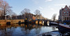 Amsterdam. (alamsterdam) Tags: amsterdam canals brouwersgracht prinsengracht reflections winterday sunlight cafepapeneiland bikes people architecture westertower