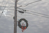 Wreath (Tony Webster) Tags: christmaswreath cleveland lakeshoredrive lincolnavenue municipalpark wisconsin electricallines holidaywreath powerlines winter wreath unitedstates us